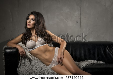 Brunette sexy woman posing in grey lingerie.  - stock photo