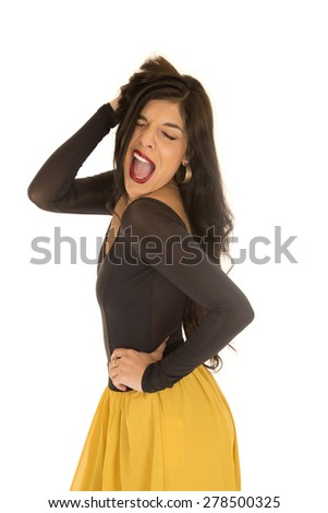 Brunette standing posing funny expression mouth open - stock photo