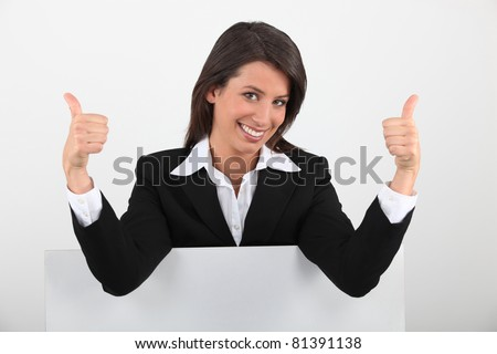 Brunette stood with message board - stock photo