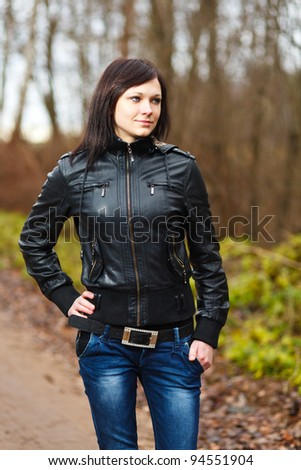 Brunette teen girl at forest. - stock photo