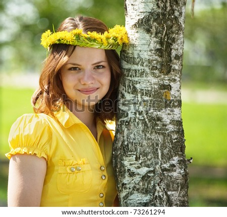 Brunette teen girl in  flowers wreath  near birch - stock photo