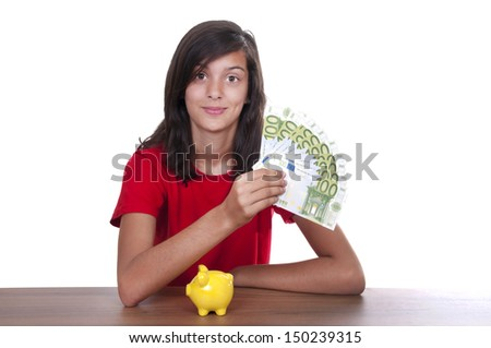 brunette teen girl with piggy bank and bills of 100 euros on white background - stock photo