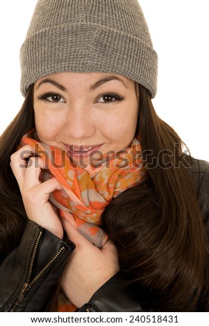 Brunette teen model snuggling hat and beanie - stock photo