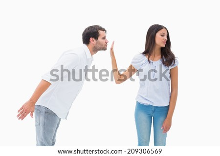 Brunette uninterested in mans advances on white background - stock photo