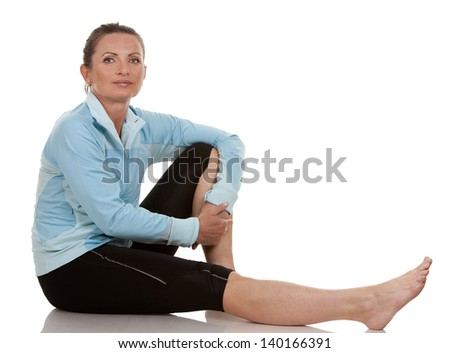 brunette wearing fitness wear on white background