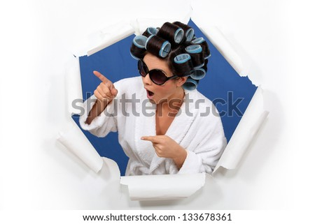 Brunette wearing hair-rollers and sunglasses - stock photo