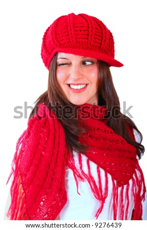 Brunette with a red hat and a red shawl, winking - stock photo