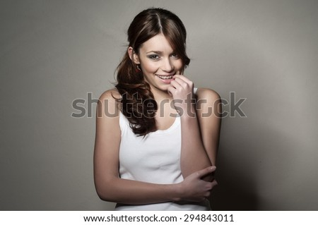 brunette with braces in a white top - stock photo