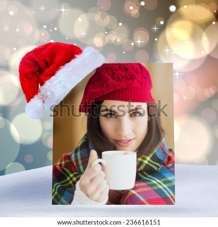 Brunette with cover holding mug against light glowing dots design pattern - stock photo