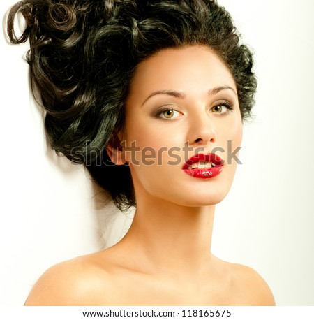 brunette with curly hair and red lipstick