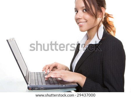 brunette with laptop smiling - stock photo