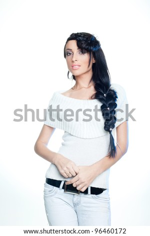 Brunette with long hair at a studio - stock photo