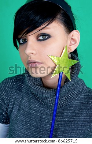 Brunette with magic wand. - stock photo