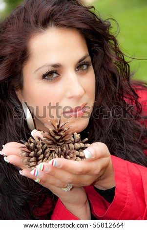 Brunette with pince cones - stock photo