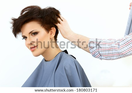 Brunette with Short Hair in Hair Salon. Hairdresser doing Hairstyle. Haircut. Hair care - stock photo