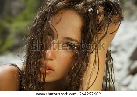 brunette with wet hair. shot on the beach. summer style. horizontal - stock photo
