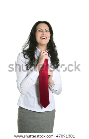 Brunette woman adjusting her necktie businesswoman isolated on white - stock photo