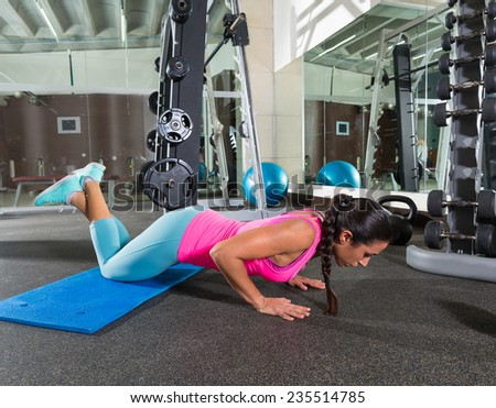 brunette woman at gym knees push up push-up workout exercise - stock photo