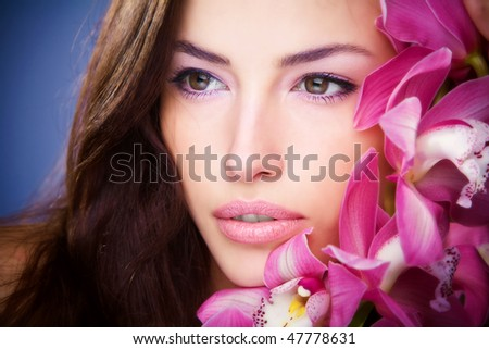 brunette woman beauty portrait with orchid - stock photo