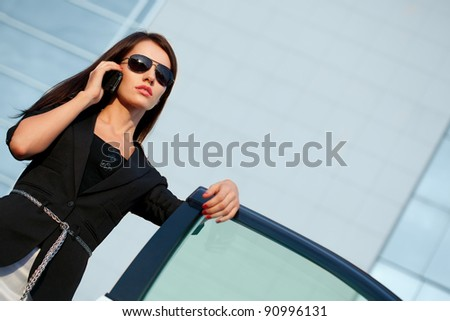 brunette woman calling by mobile phone - stock photo