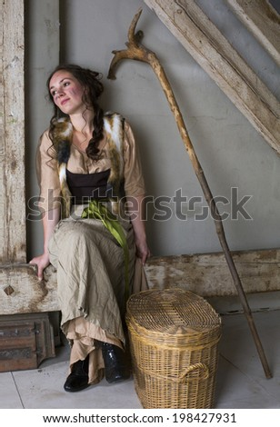 brunette woman dressed as cinderella and yawning - stock photo