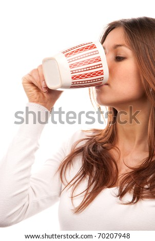 Brunette woman drinking and holding red pattern mug of tea coffee in hand isolated on white background - stock photo