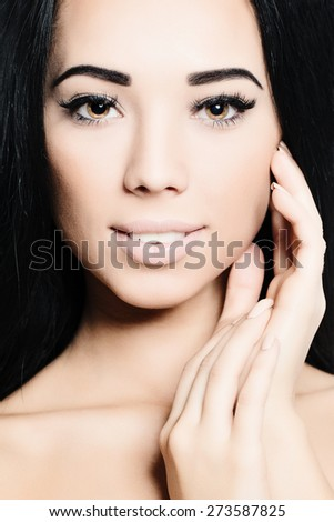 Brunette Woman. Face and Hand closeup. Spa Beauty