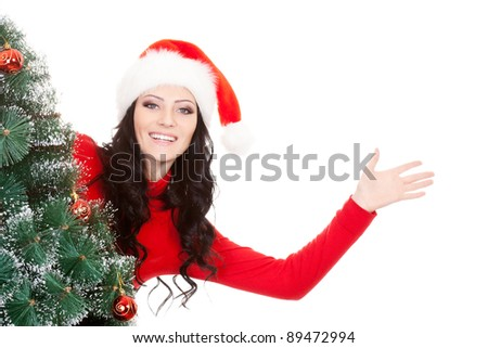 brunette woman hiding behind and show hello sign - stock photo