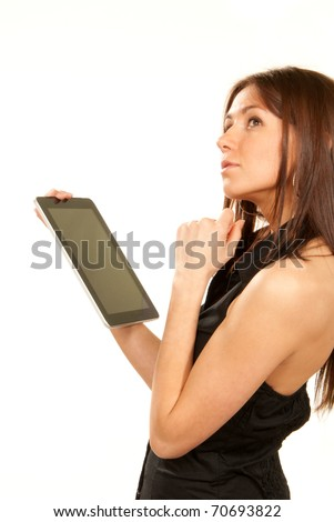 Brunette woman holding new electronic tablet touch pad computer pc and thinking about idea, one hand touches the digital screen isolated on a white background - stock photo