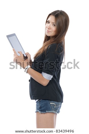 Brunette woman holding new electronic tablet touch pad computer pc and thinking about idea, one hand touches the digital screen isolated on a white background