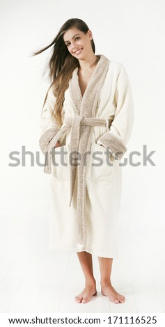 brunette woman in bathrobe - stock photo