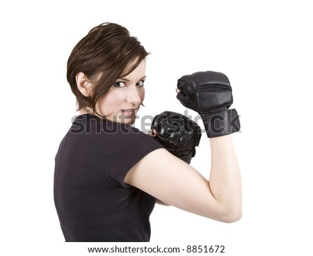 Brunette woman in boxing attire smiling at the camera. - stock photo