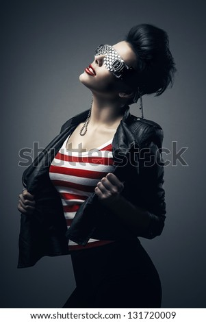 brunette woman in creative glasses - stock photo