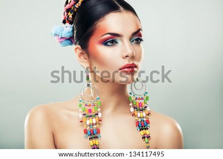 brunette woman in long earrings - stock photo
