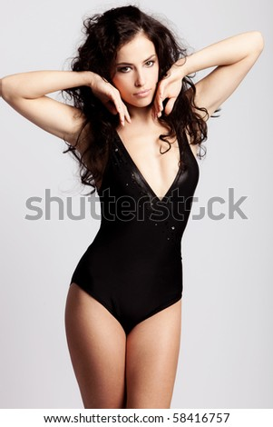 brunette woman in swimsuit studio shot
