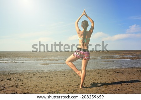 Brunette woman in yoga position. Meditation, health, wellness and zen photography. - stock photo