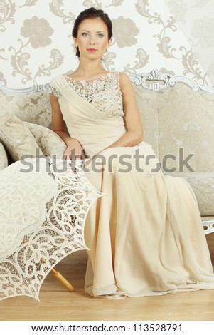 Brunette woman, indoor shot - stock photo