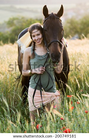 brunette woman kissing beautiful horse