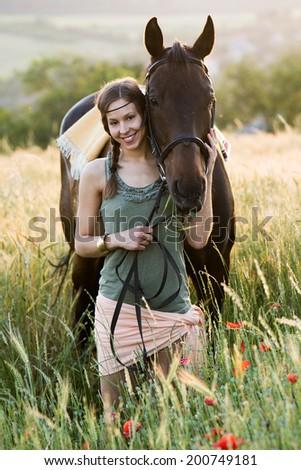 brunette woman kissing beautiful horse - stock photo