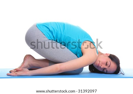 Brunette woman on a yoga mat in a Balasana position also known as the Childs pose, isolated on a white background. - stock photo