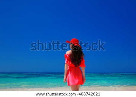 Brunette Woman on azure sea,Tropical Beach. Attractive girl in red dress resting, outdoor portrait. Bliss freedom concept. Travel. - stock photo
