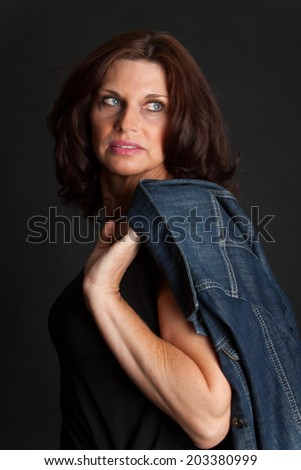 brunette woman on black - stock photo