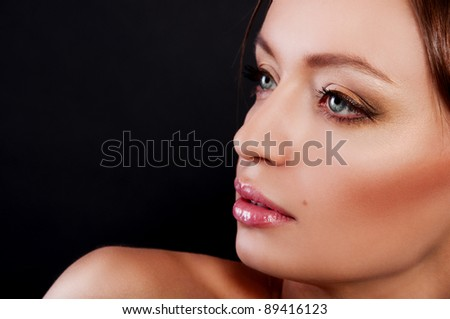 brunette woman on black background