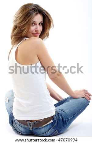 brunette woman sitting on the floor and looking back