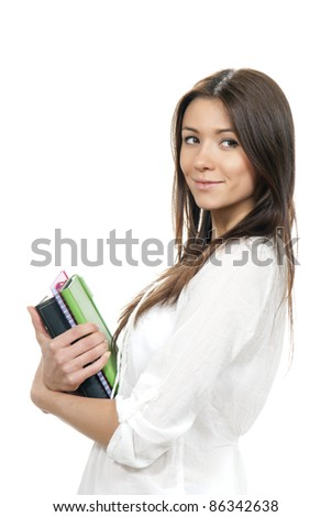 Brunette woman student hold books, textbooks, notebook, homework study assignment in library isolated on white background - stock photo