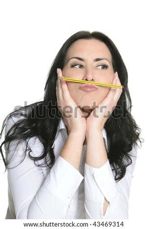 Brunette woman thinking with pencil isolated on white - stock photo