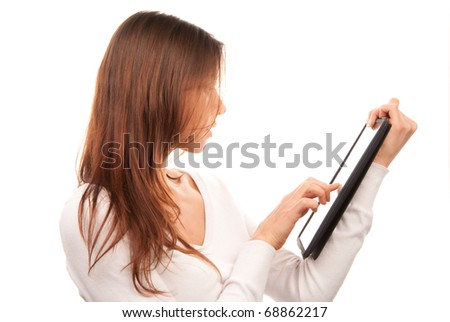 Brunette woman typing on her new electronic tablet touch pad computer pc one finger touches the digital screen other holding touch-pad isolated on a white background