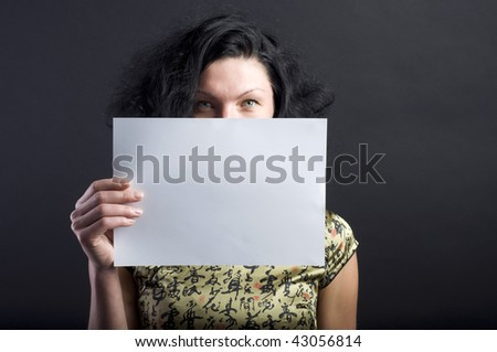 brunette woman with blank sheet of paper