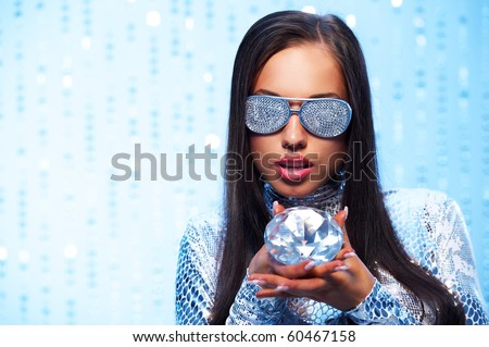 Brunette woman with diamond - stock photo