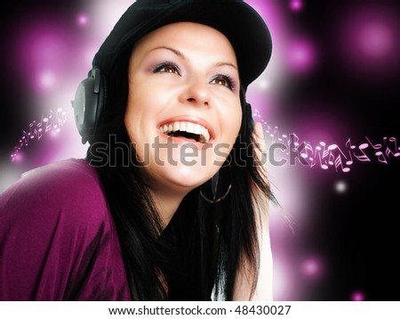 brunette woman with headphones listening music